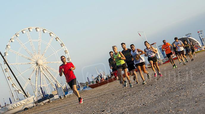 Running in spiaggia